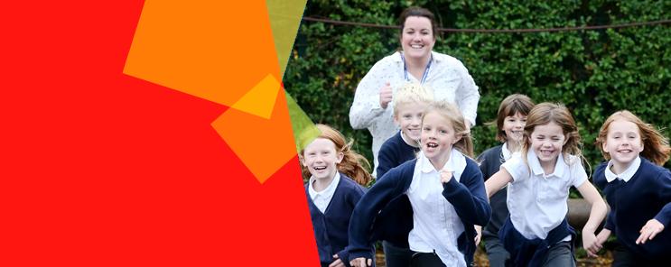 Children runnning in school playground